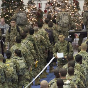 Trainees stand in line for processing at the Solomon Center on Fort Jackson Dec. 18 as he prepares to depart on Victory Block Leave. Rougly 6,000 trainees from Fort Jackson will be traveling home for the holidays before coming back to their post to continue training.